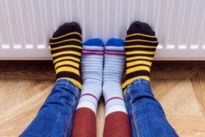 Feet by heater