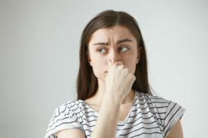 Do odd smells coming from the vents mean my furnace needs a repair?